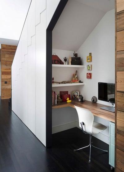 office desk under hallway stairs