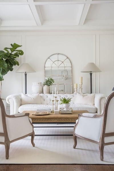Elegant white lounge area with white sofa