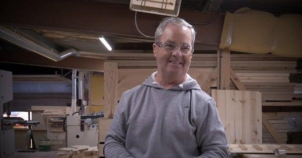 Happy Craftsman at revival beds workshop