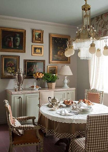 traditional dining room with light greens, brown and pink patterned furniture and artwork