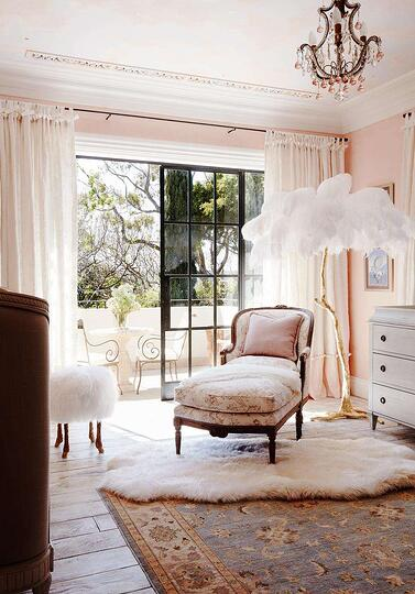 light pink bedroom with balcony, chaise seat and elegant standing lamp with white feather shade