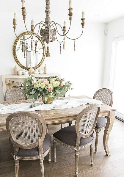 distressed wood dining table and chairs in grey and white rustic french dining room