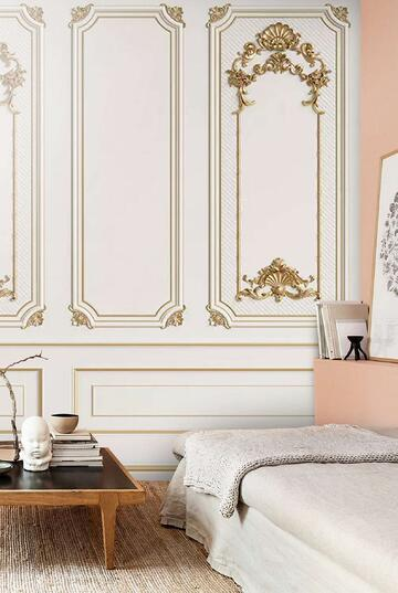 white wall with gold-edged wood panelling