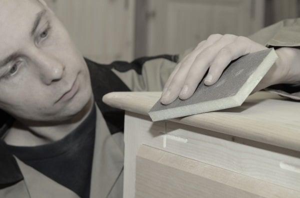 Craftsman-sanding-furniture