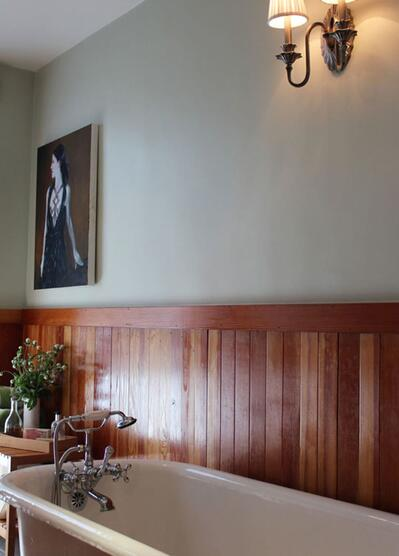 chestnut half wall wood panelling in room