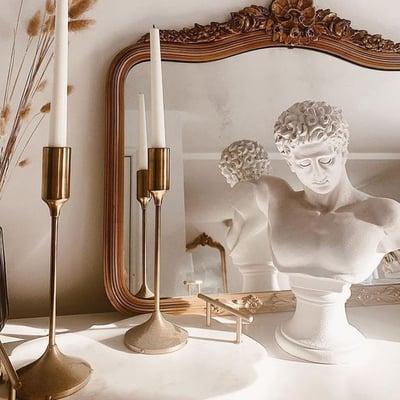elegant living room with sculptures