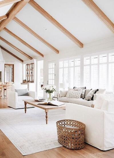 elegant living room with wooden beams