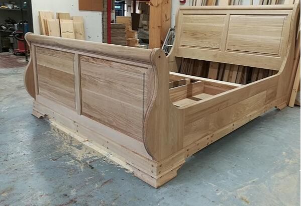 sleigh bed with bespoke additions in workshop